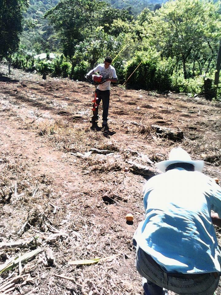 Farmer prepping soil